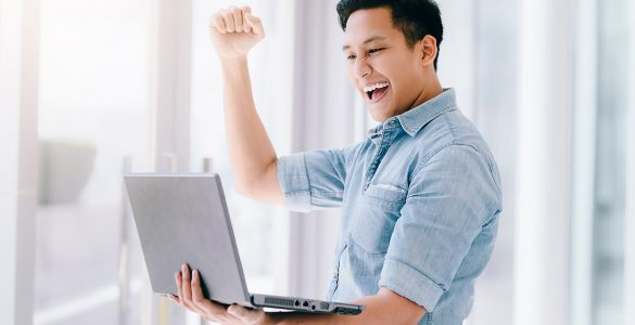 guy-excited-about-something-on-laptop