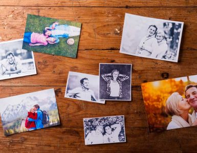 photographs on wooden table top