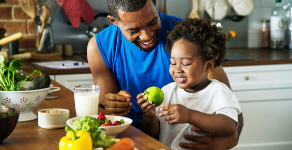 dad-and-son-eat-fruit-together