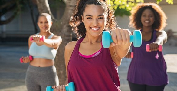 three-women-use-weights-to-workout-outdoors