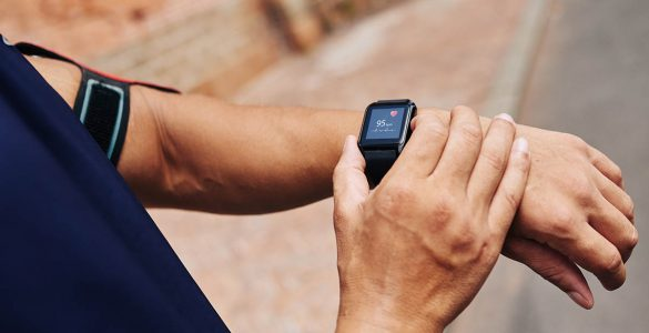 man checks his pulse on a fitness tracker smart watch