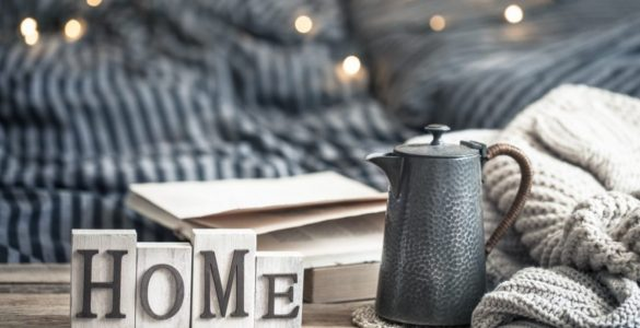 blanket and coffee pot on a table
