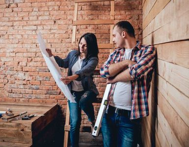looking at plans for home renovation