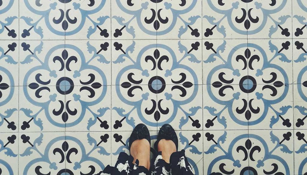 looking down at shoes on Moroccan tile floor